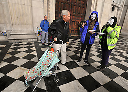 © Licensed to London News Pictures. 26/10/2011. London, UK. Protesters hand out biscuits to visitors. Occupy London protesters outside St Paul's Cathedral today, 26 October 2011. The UK's most popular Cathedral still has its doors closed over health and safety fears for it's visitors. Photo: Stephen Simpson/LNP