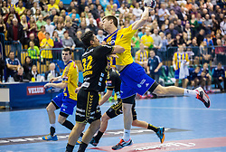 Alexander Petersson of RNL vs Sime Ivic of Celje PL during handball match between RK Celje Pivovarna Lasko (SLO) and Rhein-Neckar Loewen (GER) in Round 6 of EHF Champions League 2014/15, on November 23, 2014 in Arena Zlatorog, Celje, Slovenia. Photo by Vid Ponikvar / Sportida