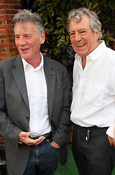 Michael Palin and Terry Jones  at the unveiling of a  blue plaque dedicated to former Monty Python Graham Chapman at his local pub the Angel in Highgate, North London, Thursday, 6th September 2012  Photo by: Stephen Lock / i-Images