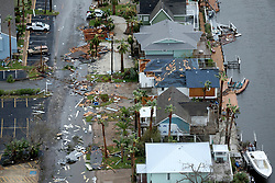 August 27, 2017 - Rockport, Texas, U.S. - Storm-damaged Rockport, Texas homes are seen in this Sunday, aerial photo. Hurricane Harvey made landfall late Friday night in Rockport as a Category 4 storm. (Credit Image: © San Antonio Express-News via ZUMA Wire)