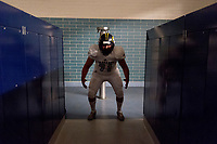 Inderkum Tigers Julian Hernandez (71), gets ready inside the locker room before the game as the Elk Grove thundering Herd varsity football team host the Inderkum Tigers,  Friday Aug 25, 2017.<br /> photo by Brian Baer