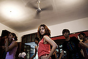 YANGON, MYANMAR, MARCH 2012: Rehearsal with the dance crew at Nicole May's house, central yangon.<br /> Burma is a country in Transition. And if that hasn't been made clear enough by the political debates and the recent by-elections, meet the Me N Ma Girls, the first girlband in the country.<br /> The timing couldn't be better. After the April 1st elections in 2012 an always increasing number of investors from all over the world has been visiting Myanmar. After decades of military regime and isolation, the strings of censorship have started loosening up. The government censors in fact for years have banned songs and articles, deleting anything that was seen as &quot;to provocative&quot; such as leather outfits and colored wigs.<br /> Describing themselves as Myanmar's first all-girl group, under the management of the Australian dancer and choreographer Nicole May, these five women - coming from either Buddhist or Catholic background and formerly known as Tiger Girls - not only have been challenging censorship laws but they're as well trying to win hearts in a society that in many ways remains man-dominated and socially conservative.<br /> In a country that has been locked up for years, the Me N Ma Girls, embracing western pop culture with skimpy outfits and catchy songs, show with every performance the will of the Burmese youth to come out of a decades-long isolation.<br /> Five girls leading a new form of rebellion: the kind that questions roles and cultural norms.