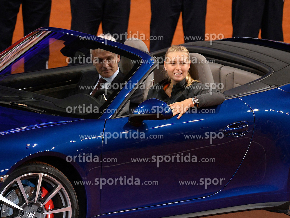 28.04.2013, Porsche Arena, GER, WTA, Porsche Tennis Grand Prix Stuttgart, im Bild Maria SHARAPOVA auch SCHARAPOWA (RUS) Siegerehrung im Porsche 911 Carrera 4S Cabriolet mit Pokal, links sitzt Vorstandsvorsitzender Matthias Müller CEO Porsche AG // during WTA Porsche Tennis Grand Prix at the Porsche Arena, Stuttgart, Germany on 2013/04/28. EXPA Pictures © 2013, PhotoCredit: EXPA/ Eibner/ Weber, ***** ATTENTION - OUT OF GER *****. EXPA Pictures © 2013, PhotoCredit: EXPA/ Eibner/ Weber..***** ATTENTION - OUT OF GER *****