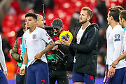 The referee hands England forward Harry Kane the match ball at full time for scoring his hat trick during the UEFA European 2020 Qualifier match between England and Montenegro at Wembley Stadium, London, England on 14 November 2019.