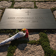The gravesite of U.S. President John F. Kennedy, in Arlington National Cemetery, in Arlington County, Virginia. The cemetery is directly across the Potomac River and the Lincoln Memorial. U.S. war casualties, and deceased veterans, of the nation's conflicts beginning with the American Civil War, are interred in this cemetery.  <br />