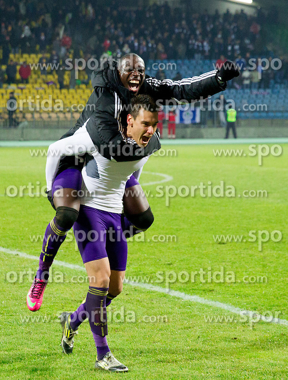 Soares Bordignon Arghus #44 of Maribor and Jean Philippe Mendy #14 of Maribor celebrate after winning during football match between NK Maribor and Wigan Athletic FC (ENG) in Round 6 of Group D of UEFA Europa League 2014, on December 12, 2013 in Stadion Ljudski vrt, Maribor, Slovenia. Maribor won against Wigan 2-1 and qualified to next Stage. Photo by Vid Ponikvar / Sportida