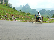 Cao Bang area in the north of Vietnam. Man driving a motorbike on the road.