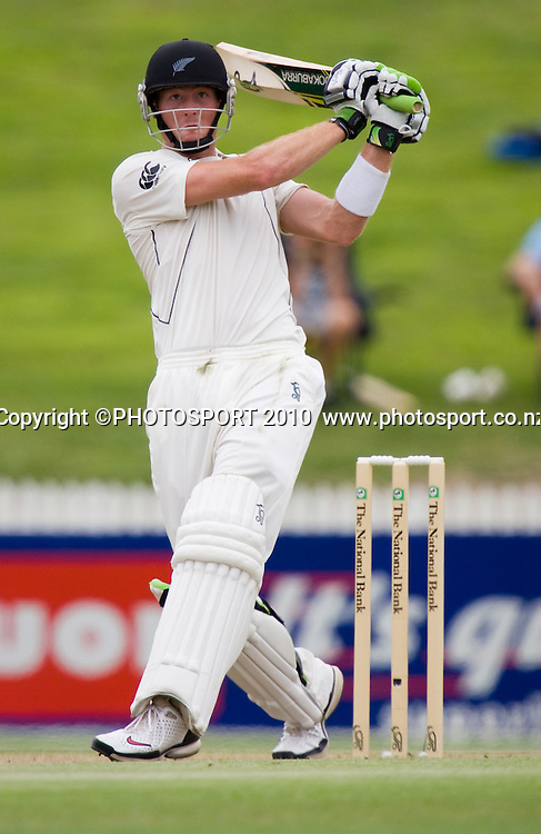 Martin Guptill hits after scoring his century during day 2 of the one off test cricket match between New Zealand Black Caps and Bangladesh at Seddon Park, Hamilton, New Zealand, Tuesday 16 February 2010. Photo: Stephen Barker/PHOTOSPORT