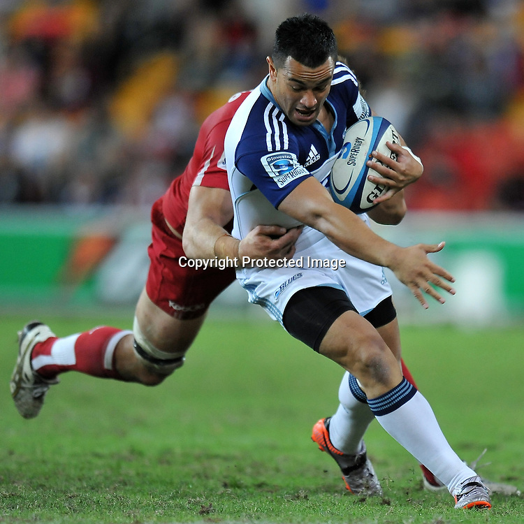 Sherwin Stowers is caught from behind by Scott Higginbotham during action from Super 15 rugby (Round 13) - Queensland Reds v Auckland Blues played at Suncorp Stadium, Brisbane, Australia on Friday 13th May 2011 ~ Photo : Steven Hight (AURA Images) / Photosport