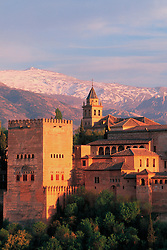 Europe, Spain, Andalucia, Grenada, Alhambra, palace and fortress complex constructed during the mid 14th century by Moorish rulers, with snowcapped Sierra Nevada mountains in distance.