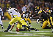 October 10, 2009: Michigan quarterback Tate Forcier (5) tries to recover his fumble during the first half of the Iowa Hawkeyes' 30-28 win over the Michigan Wolverine's at Kinnick Stadium in Iowa City, Iowa on October 10, 2009.