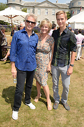 Left to right, DON FELDER  American musician and songwriter, best known for his work as lead guitarist for the Eagles, the COUNTESS OF MARCH and her son the HON.WILLIAM GORDON-LENNOX at the Cartier 'Style et Luxe' part of the Goodwood Festival of Speed, Goodwood House, West Sussex on 14th July 2013.