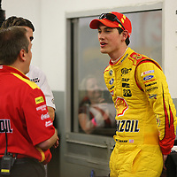 Driver Joey Logano is seen in his garage area during the 56th Annual NASCAR Daytona 500 practice session at Daytona International Speedway on Wednesday, February 19, 2014 in Daytona Beach, Florida.  (AP Photo/Alex Menendez)