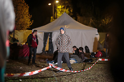 03.10.2015, Grenzübergang, Salzburg - Freilassing, GER, Flüchtlingskrise in der EU, im Bild ein Flüchtlingskind // a refugee child walks trought the Camp. Europe is dealing with its greatest influx of migrants and asylum seekers since World War II as immigrants fleeing war and poverty in the Middle East, Afghanistan and Africa try to reach Germany and other Western European countries, German - Austrian Border, Salzburg, Austria on 2015/10/03. EXPA Pictures © 2015, PhotoCredit: EXPA/ JFK