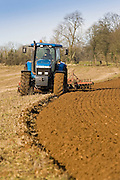 Tractor ploughing field in Oxfordshire, The Cotswolds, United Kingdom
