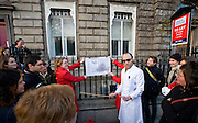 Professor Coyle Demonstrates the Physics of Banana Skin Falls outside the Dublin Institute of  Advanced Studies School of Cosmic Physics, Merrrion Square, Dublin, during the Walking Tour of Places of No Historical Interest, Festival of Fools, April 1st 2009, marking April Fool's Day, and the 43rd anniversary of the death of Irish author Flann O'Brien