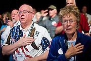 26 FEBRUARY 2011 - PHOENIX, AZ: TOM GRIMES, from South Bend, Indiana, sore an American flag shirt and says the Pledge of Allegiance during the opening of the Tea Party Patriots American Policy Summit in Phoenix Saturday. The summit goes through Sunday Feb. 27. About 2,000 people are attending the event, which organizers said is meant to unite Tea Party groups across the country. Speakers include former Minnesota Governor Tim Pawlenty, Texas Congressman Ron Paul, former Clinton advisor Dick Morris and conservative blogger Andrew Brietbart. The event ends with a presidential straw poll Sunday.   Photo by Jack Kurtz