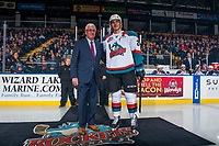 KELOWNA, CANADA - JANUARY 10: Cal Foote #25 of the Kelowna Rockets stands on the ice with General Manager, Bruce Hamilton upon his return to the team after winning gold at the World Junior Championships as part of Team Canada on January 10, 2017 at Prospera Place in Kelowna, British Columbia, Canada.  (Photo by Marissa Baecker/Shoot the Breeze)  *** Local Caption ***