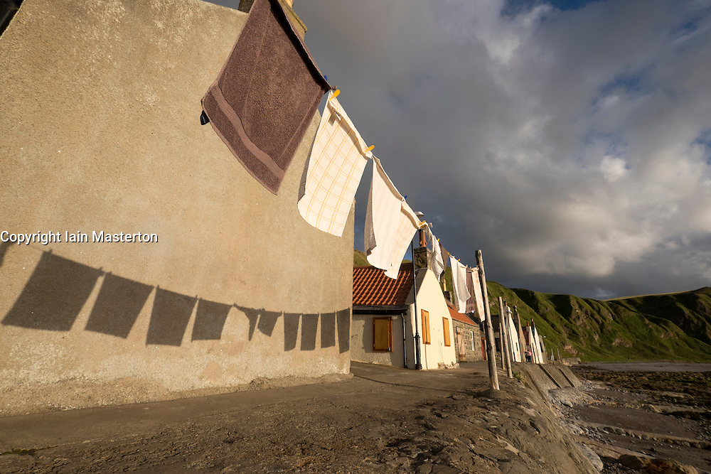 Washing hanging out to dry in small village of Crovie on coast of Aberdeenshire in Scotland
