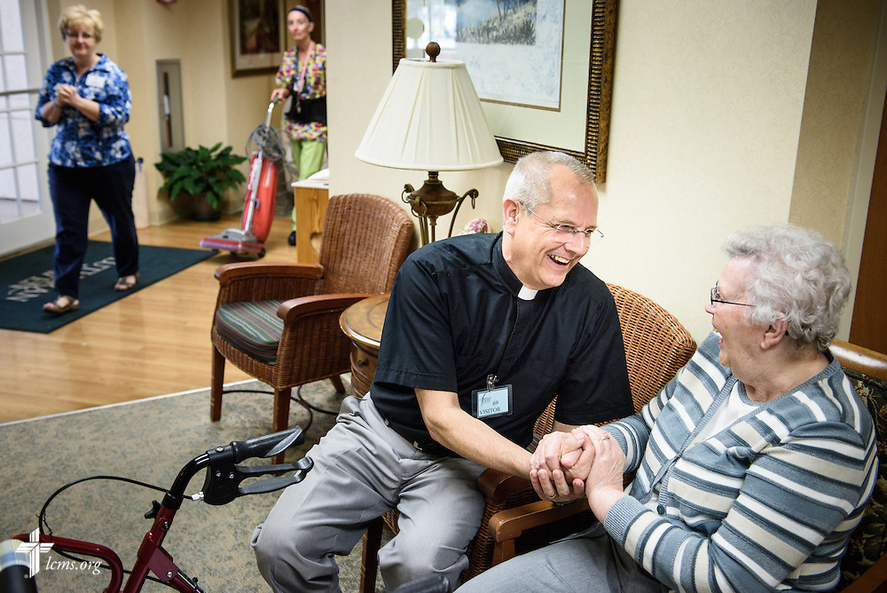 The Rev. Wally Arp, senior pastor at St. Luke's Lutheran Church, visits with residents at the Lutheran Haven senior living home adjacent to the parish on Monday, March 7, 2016, in Oviedo, Fla. LCMS Communications/Erik M. Lunsford