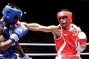 Milan, 04-09-2009 ITALY - Aiba World Boxing Championship Milan 2009.  Light Welter 64 kg preliminaries..Pictured:  Vangeli Dario ITA red vs Lawson Frederick GHA blue.Photo by Giovanni Marino/OTNPhotos . Obligatory Credit