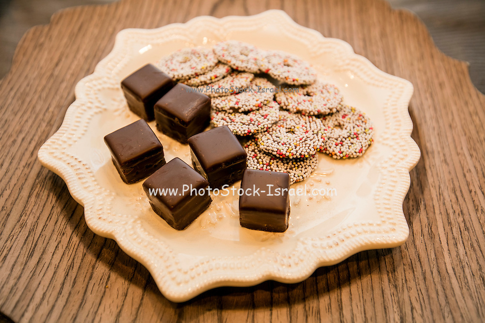 a plate of chocolates and cookies
