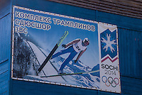 Russia, Sakhalin, Yuzhno-Sakhalinsk. Ski jumping hill, a billboard advertising the Winter Olympics 2014 in Sochi.