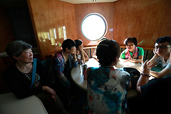 80 year-old Wang Fuying, who has a lesbian granddaughter, listens to other parents sharing their experiences on a cruise organised by the Parents and Friends of Lesbians and Gays (PFLAG) China organisation in open seas on route back to Shanghai China, 17 June 2017. Wang has accepted her granddaughter and see that it is something she could not change.About 800 members of the Chinese LGBT (lesbian, gay, bisexual and transgender) community and their parents spent four days on a cruise trip organised by Parents and Friends of Lesbians and Gays (PFLAG) China, a grassroots non-government organisation, celebrating the 10th anniversary of the organisation. It aims to promote coexistence among homosexuals and their families.