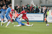 Jabo Ibehre (Carlisle United) is tackled by the Hartlepool United player who puts it out for a throw in during the EFL Sky Bet League 2 match between Hartlepool United and Carlisle United at Victoria Park, Hartlepool, England on 14 April 2017. Photo by Mark P Doherty.
