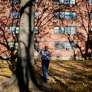 "BROOKLYN, NY - NOVEMBER 19, 2014:  Alexander Fitz poses for a portrait next to a tree outside his apartment in East New York. ""I told my son one day when he came to New York one day, you have to grow strong like the tree,"" he says. CREDIT: Sam Hodgson for The New York Times"