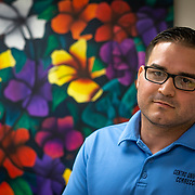 JULY 19, 2018----BAYAMON, PUERTO RICO---<br /> Inmate Giomatai Aviles Rivera in front of a painting made by him in the Bayamon Correctional Complex which is made up of four buildings. The Puerto Rico Corrections and Rehabilitation Department is in the middle of a project to downsize by transferring inmates to private jails in the United States and closing institutions like this.<br /> (Photo by Angel Valentin/Freelance)
