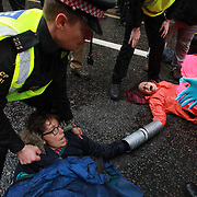 A number of activists have locked themselves together and super glued themselves to the ground in front of the finance company Goldman Sachs in Fleet Street. They want to global finace company to take drastic climate change actions. A number were arrested. They want the finance The environmental protest group Extinction Rebellion has called for civil disobedience and peaceful protest to force the British government to take drastic action on climate change. The group wants the governenmet to tell the truth and admit that the impact of climate change is much more severe than they say and that action to mitigate catastrophic climate change is urgent. For up to ten days Extinction Rebellion activists occupied Waterloo Bridge, Parliament Square, Oxford Circus and Marble Arch disrupting traffic and 'normal life'. More than a thousand people were arrested before the police finally cleared the street and the International Rebellion was called to halt by the the activists.
