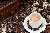 Cup of Expresso Coffee with old grinder and coffee beans.