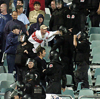 Photo. Jed Wee.<br /> Poland v England, World Cup Qualifier, Stadion Slaski, 08/09/2004.<br /> An English fan braves the Polish security.<br /> <br /> NORWAY ONLY