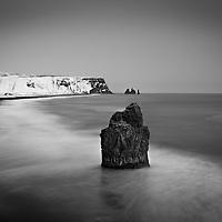 Beautiful Rock formation on REYNISFJARA black sand beach in Iceland.