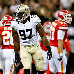 Aug 9, 2013; New Orleans, LA, USA; New Orleans Saints defensive end Jay Richardson (97) reacts after recovering a fumble against the Kansas City Chiefs during the second half of a preseason game at the Mercedes-Benz Superdome. The Saints defeated the Chiefs 17-13. Mandatory Credit: Derick E. Hingle-USA TODAY Sports