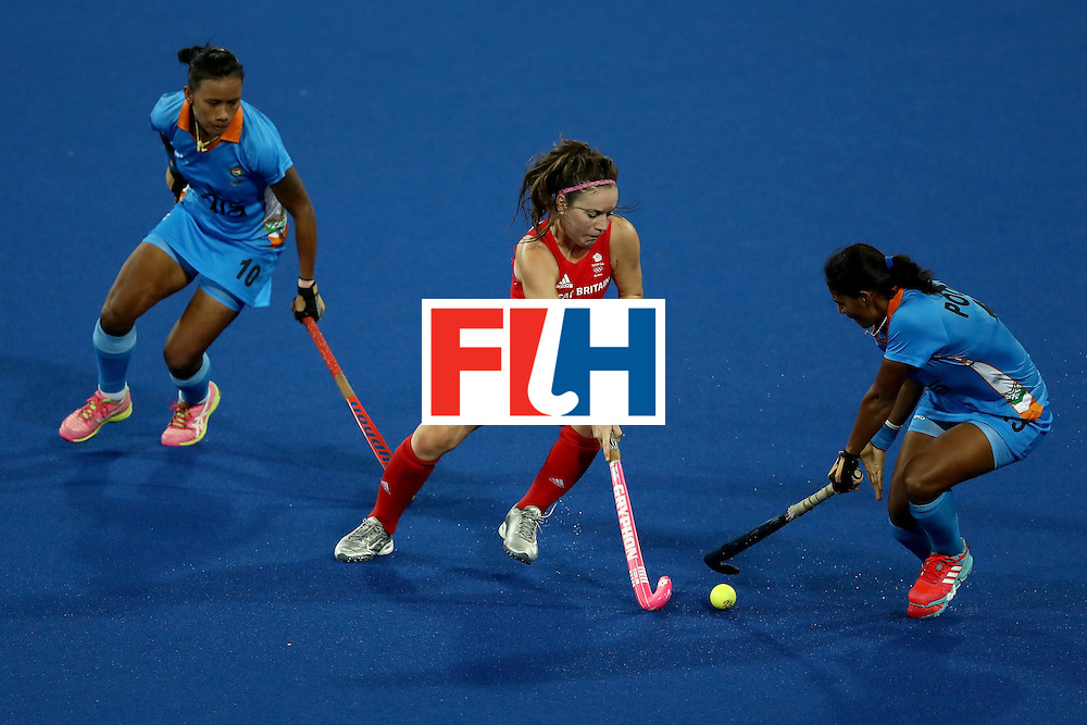 RIO DE JANEIRO, BRAZIL - AUGUST 08:  Anuradha Thokchom #10 and Poonam Rani #15 of India defend against Laura Unsworth #4 of Great Britain during a Women's Pool B match on Day 3 of the Rio 2016 Olympic Games at the Olympic Hockey Centre on August 8, 2016 in Rio de Janeiro, Brazil.  (Photo by Sean M. Haffey/Getty Images)