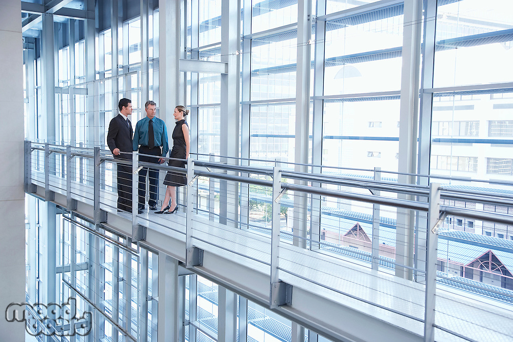 Businesspeople in modern building