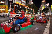 Western tourists enjoy touring Tokyo on go carts run by Mari Cart company. Shibuya, Tokyo, Japan Friday September 29th 2017 The carts that trade on the Super Mario Carts game idea and charters are a popular tourist attraction in Tokyo. Though there are safety and copyright issues that may soon force the company to stop running the tours