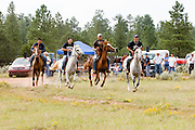 "09 SEPTEMBER 2007 -- ST. MICHAELS, AZ: The start of a two and a half mile race at a traditional Navajo Horse Race in the summit area of the Navajo Indian reservation about 10 miles west of St. Michaels, AZ. Traditional horse racing is making a comeback on the Navajo reservation. The races are run on improvised courses that vary depending on the local terrain. Use of saddles is optional (except in the ""Cowhand Race"" which requires a western style saddle) and many jockeys ride bareback. The distances vary from one mile to as long as thirty miles. Traditional horse races were common until the 1950's when they fell out of favor, but there has been a resurgence in traditional racing since the late 1990's and now there is a traditional horse racing circuit on the reservation. The race was organized by the Begay family of Steamboat, AZ and run on private land about three miles from a paved road.  Photo by Jack Kurtz"