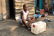 A boy plays drums on a plastic jerrican in the West Point slum in Monrovia, Montserrado county, Liberia on Monday April 2, 2012.