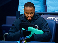 MANCHESTER, ENGLAND - Saturday, December 15, 2018: Manchester City's substitute Raheem Sterling, with a hot water bottle, before the FA Premier League match between Manchester City FC and Everton FC at the Etihad Stadium, the 232nd Merseyside Derby. (Pic by David Rawcliffe/Propaganda)