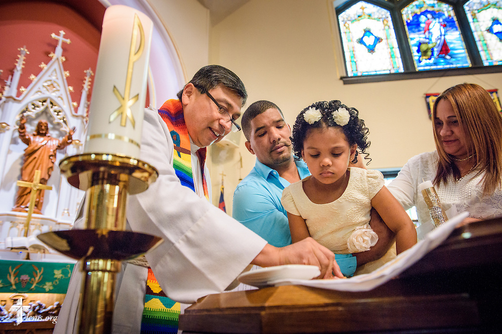 The Rev. Pablo Dominguez, pastor of a Hispanic mission in the LCMS Central Illinois District, baptizes a young girl on Saturday, Oct. 1, 2016, at St. John's Lutheran Church in Beardstown, Ill. LCMS Communications/Erik M. Lunsford