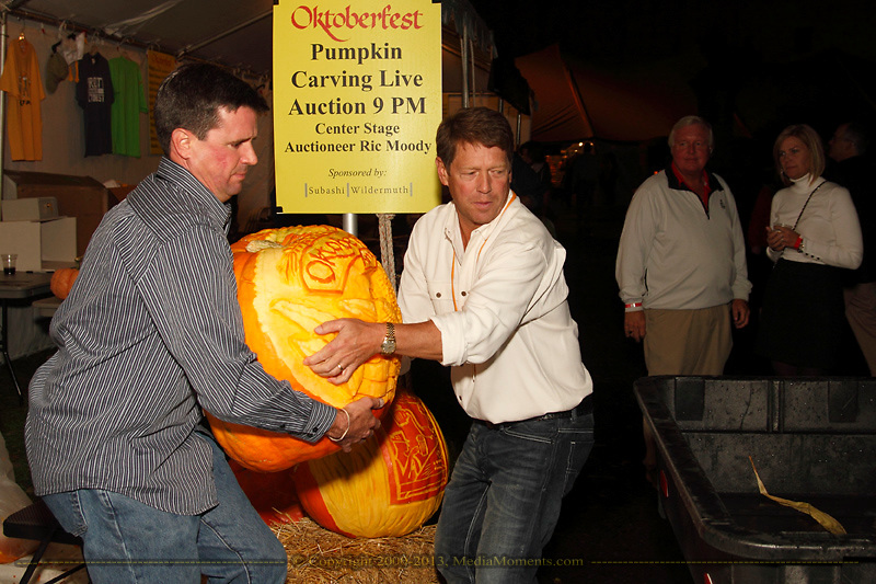 Moving the freshly carved pumpkins during the Preview Party for the 41st annual Oktoberfest at the Dayton Art Institute, Friday, September 21, 2012.