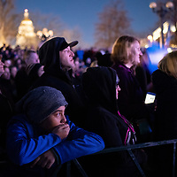 Eleven-year-old Denver resident Eliseo Rhines, left, listens to Democratic presidential candidate and former Colorado Governor John Hickenlooper during Hickenlooper's first presidential rally at the Greek Amphitheater in Denver's Civic Center Park on Thursday, March 7, 2019. Photo by Andy Colwell, special to the Colorado Sun