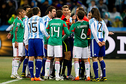 Players of Argentina and players of Mexico at referee Roberto Rosetti (ITA)  after first goal of Argentina during the 2010 FIFA World Cup South Africa Round of Sixteen match between Argentina and Mexico at Soccer City Stadium on June 27, 2010 in Johannesburg, South Africa. (Photo by Vid Ponikvar / Sportida)
