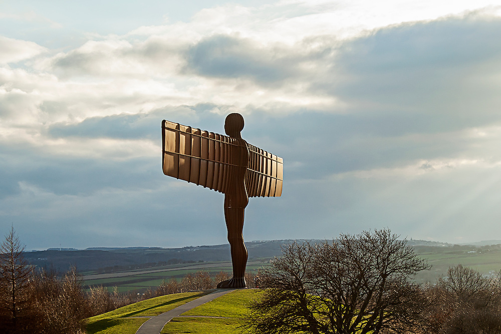 Antony Gormley's Angel of the North, a contemporary sculpture located beside the A1 road near Gateshead in the north east of England. The sculpture, made of steel, represents an angel, and stands 20 metres (66 ft) tall, with wings measuring 54 metres (177 ft) across.