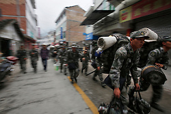 Chinese soldiers march out areas affected by the earthquake in Taiping town of Lushan County, Sichuan Province, China, 23 April 2013. The Lushan Earthquake in Sichuan Province on 20 April 2013 resulted in 186 people dead, 21 missing, 11248 injured. About 1.72 million people were affected by the quake, while an initial estimate by the International Red Cross on Saturday put the number needing emergency shelter, water and food at 120,000. The China Earthquake Administration (CEA) recorded a magnitude 7.0 earthquake, while the US Geological Survey said it had measured 6.9.