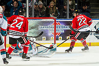 KELOWNA, CANADA - MARCH 2:  Jaydon Dureau #22 of the Portland Winterhawks puts the puck in the net of Roman Basran #30 of the Kelowna Rockets on March 2, 2019 at Prospera Place in Kelowna, British Columbia, Canada.  (Photo by Marissa Baecker/Shoot the Breeze)