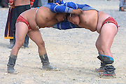 GOBI DESERT, MONGOLIA..08/26/2001.Bayangovi. Wrestling at local Naadam festival..(Photo by Heimo Aga).